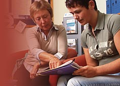 Two people discussing an information leaflet